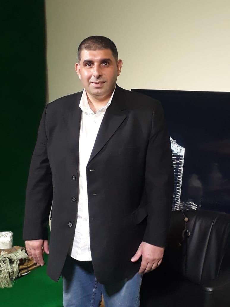 الصحافي والكاتب السياسي علي ضاحي